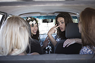 South Africa, Friends on a road trip talking in car - ZEF002687