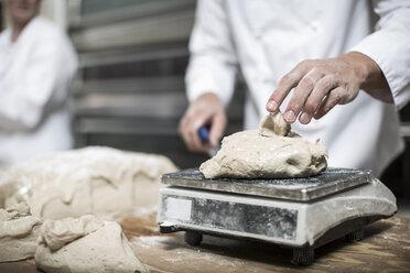 Baker weighing dough - ZEF003783