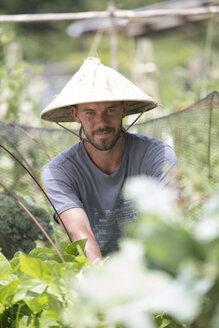 Portrait of gardener with Asian hat - ZEF004045