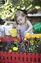 Little girl watering plants - ZEF004076
