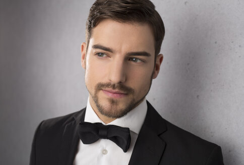 Portrait of man wearing dinner jacket and bow - SHKF000108