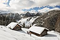 Austria, Salzburg State, Altenmarkt-Zauchensee, four skiing people - HH005017