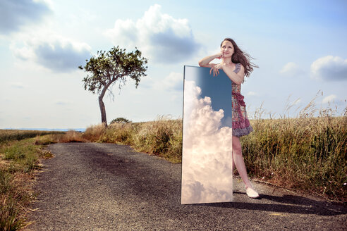 Teenage girl with mirror in rural landscape - VTF000376