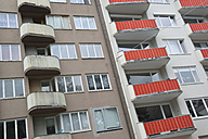 Germany, Bavaria, Munich, house front with windows and balconies in sixties style - AXF000736