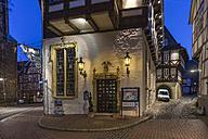 Germany, Goslar, entrance of hotel Brusttuch at night - PVCF000257