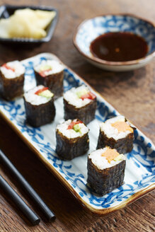 Vegetable sushi filled with sweet potato, carrots, avocado and bell pepper - HAWF000560