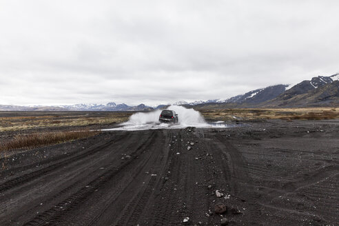 Iceland, Porsmoerk, car driving through water - ATAF000088