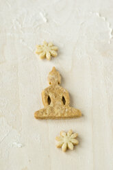 Home-baked Buddha cookie on light wood - MYF000799