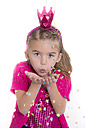 Portrait of little girl masquerade as a princess blowing confetti - YFF000288