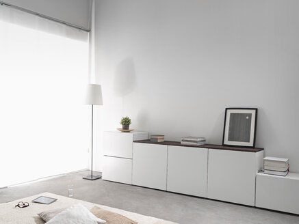 White sidebord in a modern living room - PDF000660