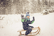 Germany, Bavaria, Berchtesgadener Land, happy boy on sledge - MJF001382