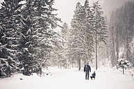 Germany, Bavaria, Berchtesgadener Land, father and son with sledge in winter landscape - MJF001414