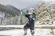 Germany, Bavaria, Berchtesgadener Land, happy boy in winter landscape - MJF001412