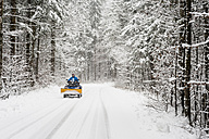 Germany, Bavaria, Berchtesgadener Land, man on quadbike in winter landscape - MJ001422