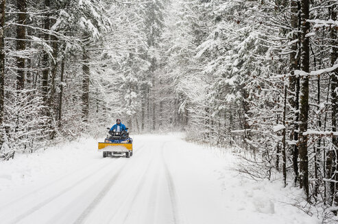 Germany, Bavaria, Berchtesgadener Land, man on quadbike in winter landscape - MJ001422