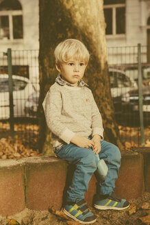 Portrait of pensive toddler at playground - MFF001355