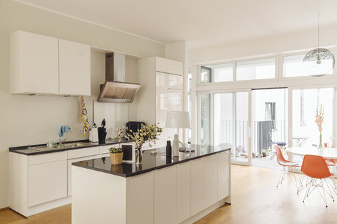Kitchen with counter island and table in modern building - MFF001366