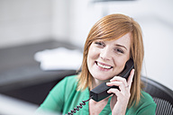 Smiling businesswoman on the phone in office - ZEF003037