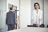 Businesswoman in conference room after business meeting - ZEF003051