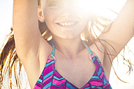 Portrait of smiling girl on the beach - ZEF003300