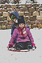 Two little girls sitting on a sledge - LVF002547