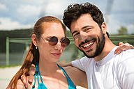 Portrait of smiling young couple outdoors - WESTF020730