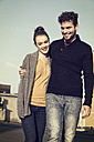 Happy young couple walking outdoors - MEMF000635
