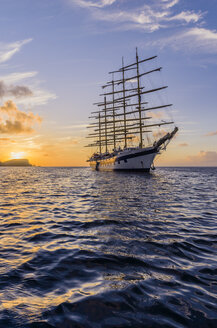 Caribbean, Antilles, Lesser Antilles, Grenadines, Bequia, Caribbean Sea, Sailing ship at sunset - THA001150
