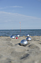 Italy, Adriatic Sea, boccia bowls in the sand - CRF002631