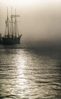 Germany, Hamburg, sailing ship in fog - KRPF001278