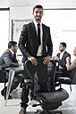 Portrait of confident businessman in boardroom - ZEF003158