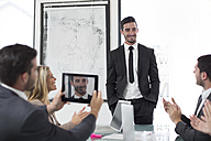Confident businessman in boardroom leading a meeting - ZEF003117