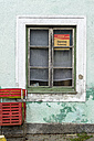 Window of guesthouse with sign 'Tuesday Closing day' - EJW000620