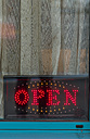 Neon sign behind windowpane of a pub - EJW000610