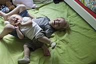 Two little brothers rampaging on bed - RB002238