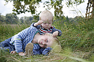Two little brothers on a meadow - RB002253