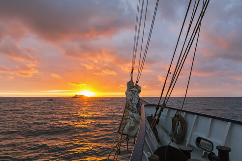 Pacific Ocean, sailing ship at Galapagos Islands at sunrise - FOF007567