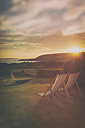 France, Brittany, Finistere, deckchairs at sunset by the sea - ON000769