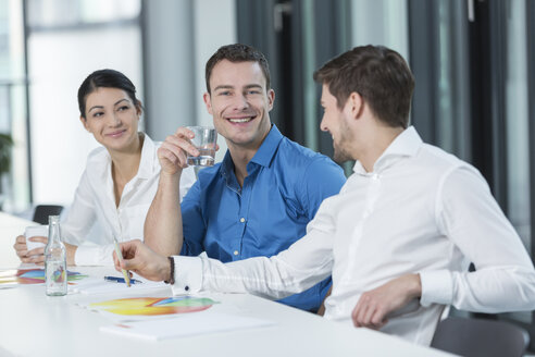 Meeting of three business people in a conference room - SHKF000150
