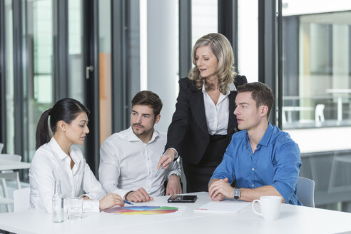 Meeting of four business people in a conference room - SHKF000156