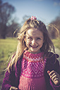 Portrait of smiling litte girl with pink knit pullover - SARF001234