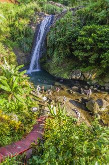 Antilles, Lesser Antilles, Grenada, group of tourists at waterfalls - THAF001167