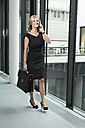 Smiling businesswoman on cell phone - SHKF000221