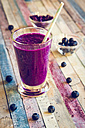 Glass of blueberry beetroot smoothie with chia seeds - SARF001240