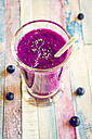 Glass of blueberry beetroot smoothie with chia seeds - SARF001242