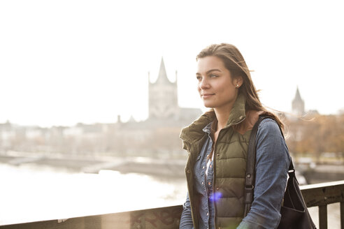 Germany, Cologne, young woman on Hohenzollern Bridge - FEXF000253