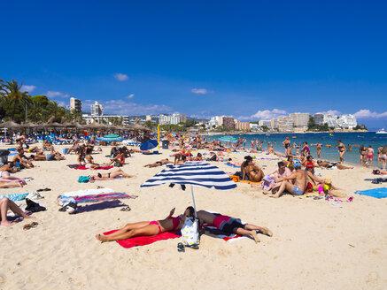 Spain, Baleares, Mallorca, Magaluf, tourists sunbathing on the beach - AM003590