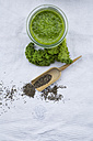Glass of kale smoothie and chia seeds - LVF002617