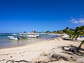 Jamaica, Runaway Bay, beach with motorboats - AMF003627