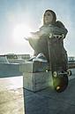 Teenage girl in skatepark - UUF003050